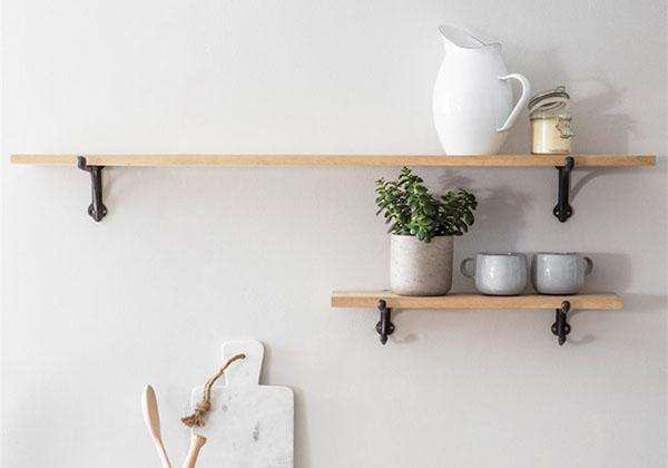 European style oak shelf with cast iron brackets