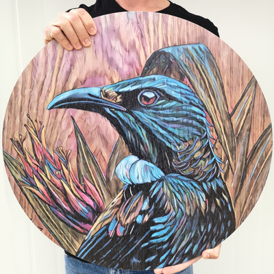 Tui in flax upon timber reworked outdoor art