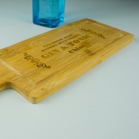 Bamboo paddle gin chopping board