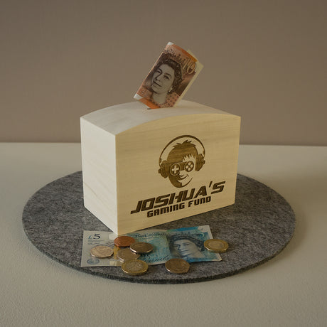 Gamer saving funds. Custom engraved video gaming money box