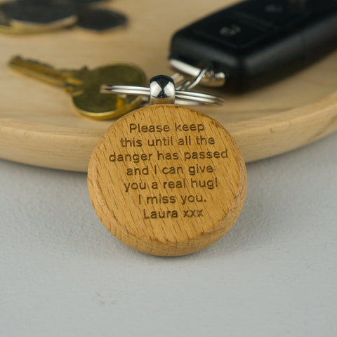 Personalised pocket hug keyring.