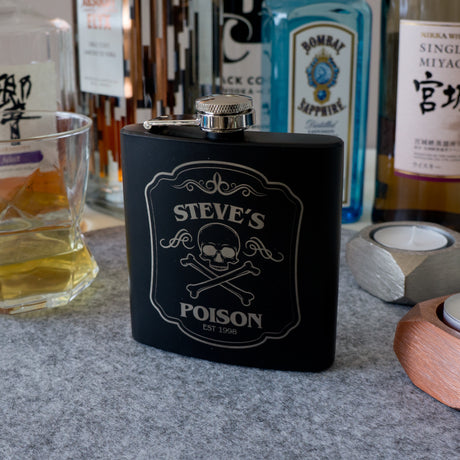 Personalised whiskey hip flask. Custom engraved skull design.
