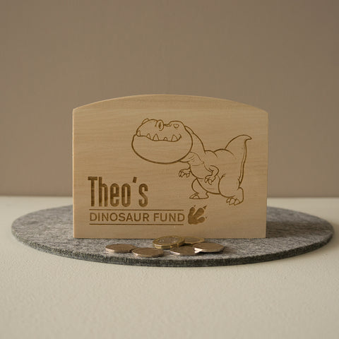 Dinosaur personalised money box. Piggy bank savings pot.
