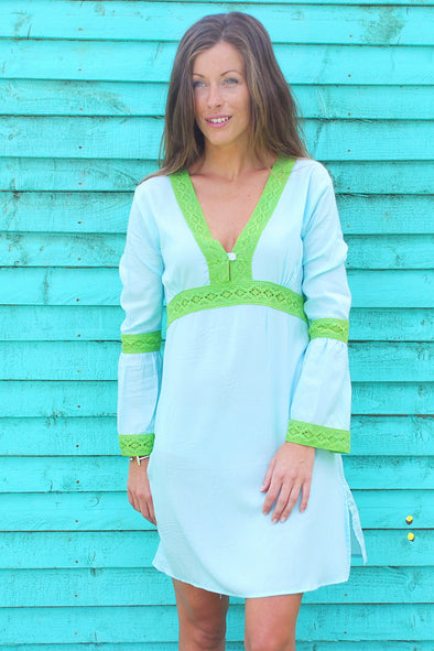 Empire style beach dress in turquoise with green lace details.  Only available in size 10.