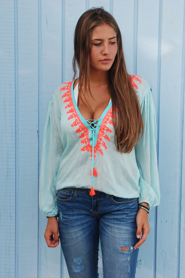 Amber beachwear kaftan top in turquoise with fluorescent embroidery.  Bohemian chic style available in one size.