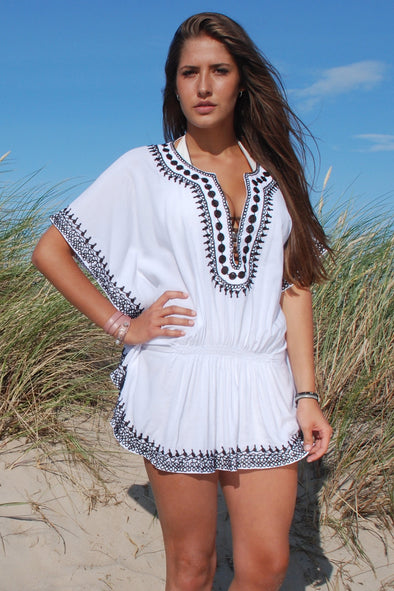 White beach dress in an ethnic poncho style, butterfly sleleves and a mini dress attached.  Chocolate embroidery to neckline.