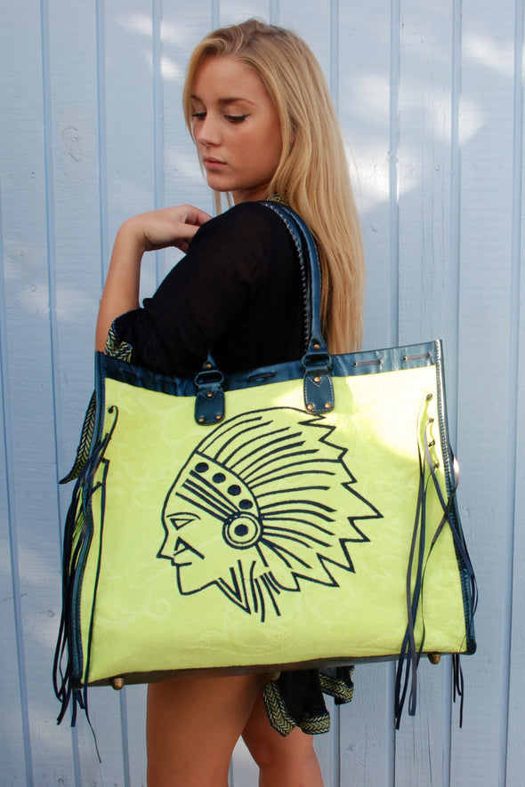 Oversized beac bag in fluorescent towelling and navy shimmer leather edging.