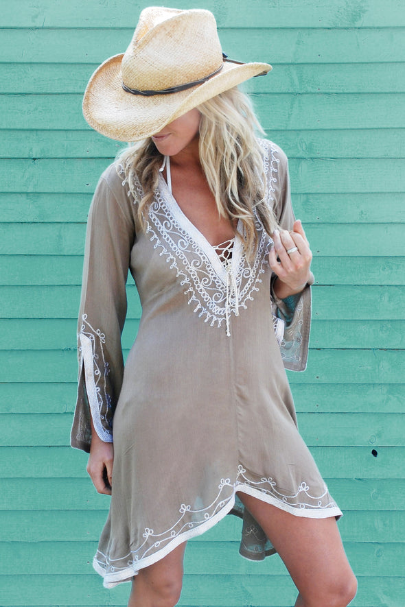 Designer Kaftan Dress, above the knee length with a deep v-neckline in taupe with gold.  Available in size medium or large