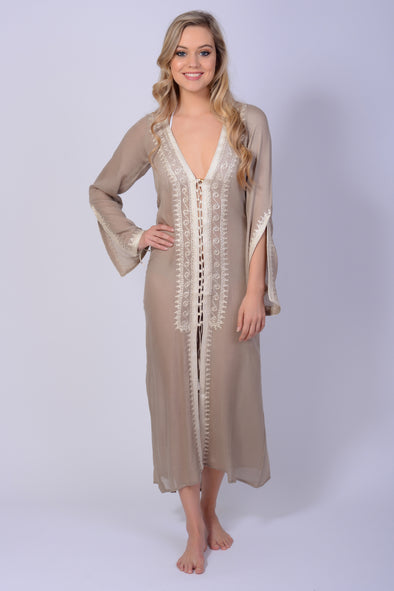 Ankle length kaftan shirt with bell sleeves in taupe with gold.  Lace up detail to front. One size fits from size 10 to 12.