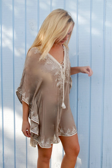 Ibiza beach tunic in taupe with gold embroidery.  Deep neckline and mid thigh length.  Fits size 8 to size 12