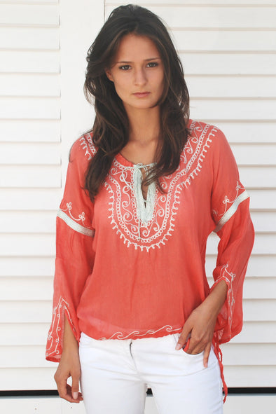 Designer kaftan top in strawberry with white embroidery.  Pretty bohemian style with neckline tie and tie to waist.  One size fits most.