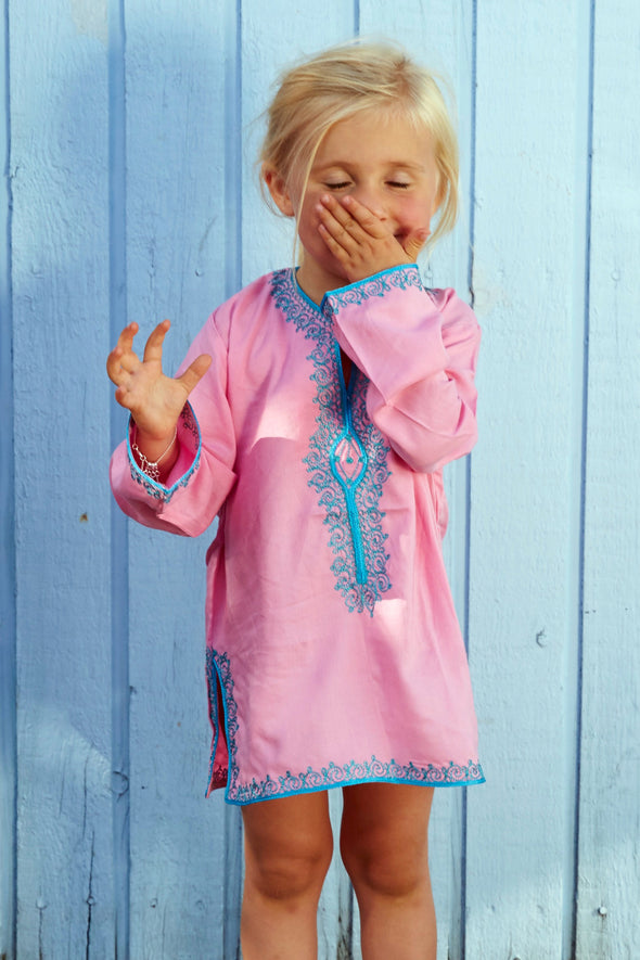 Coco kids Morocan kaftan tunic.  Pretty mid pink with blue embroidery, long sleeves and above the knee length.  Available in ages 2 to 12.