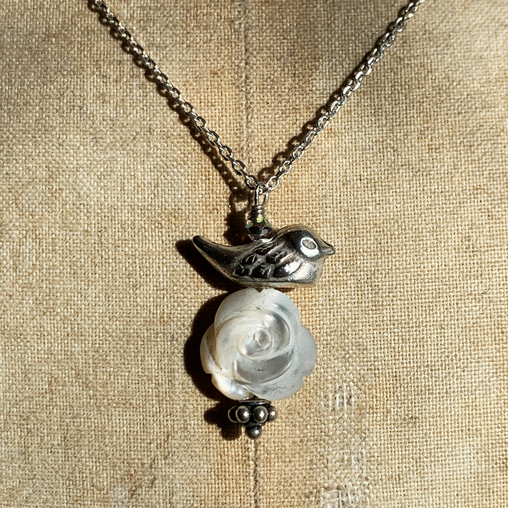 Solid Silver Bird on a Mother of Pearl Carved Rose on a Silver Necklace