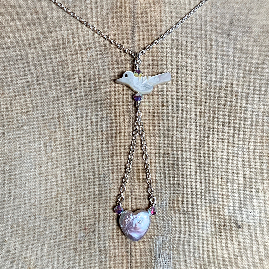 Mother of Pearl Bird with Freshwater Pearl Heart suspended on Silver Chain Necklace