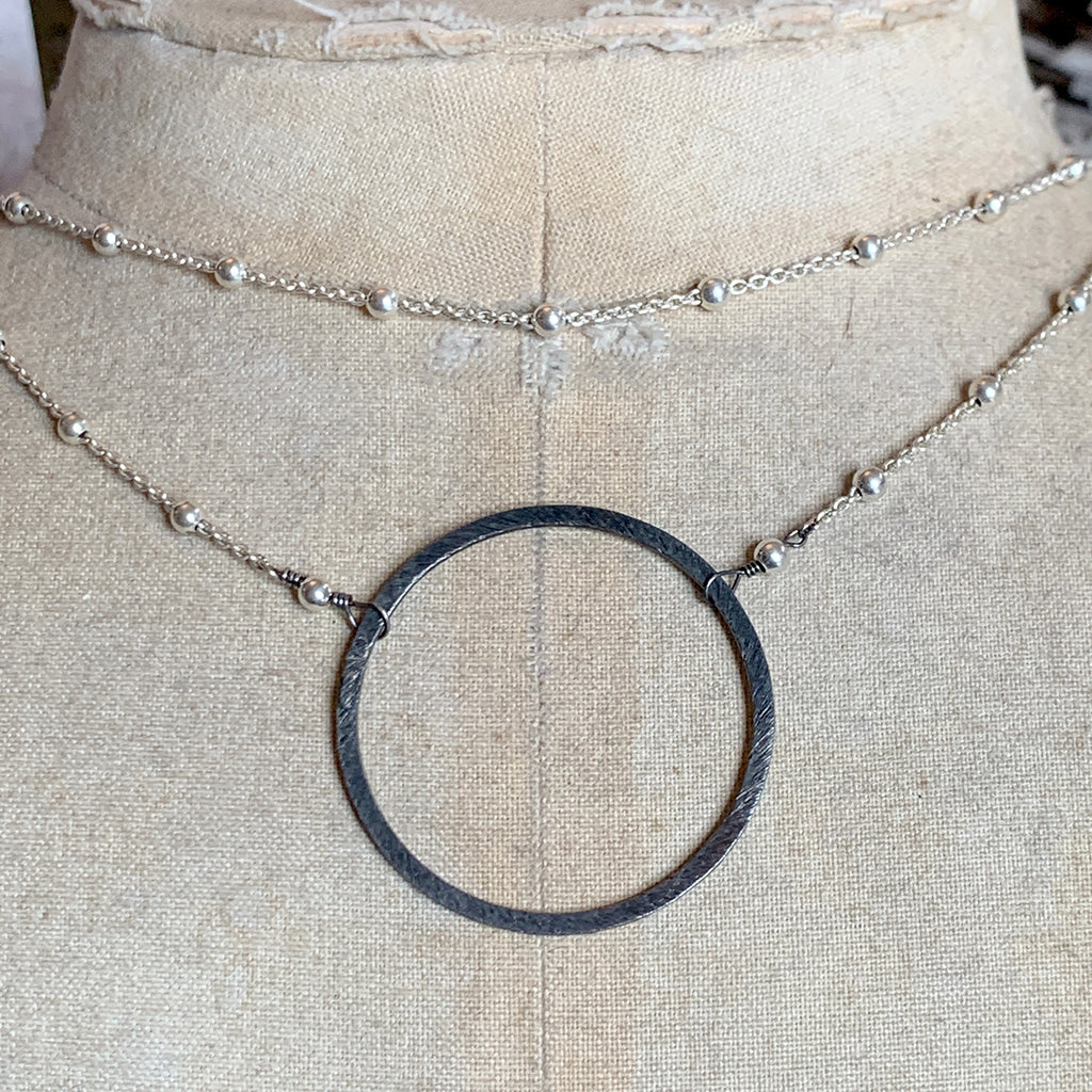 Large Oxidised Silver Halo on Bright Silver Dotted Chain Necklace