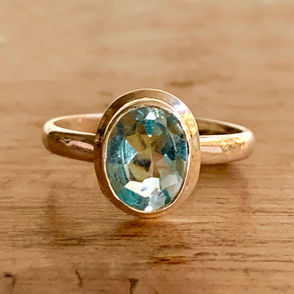 Small Oval Blue Topaz on Silver Ring