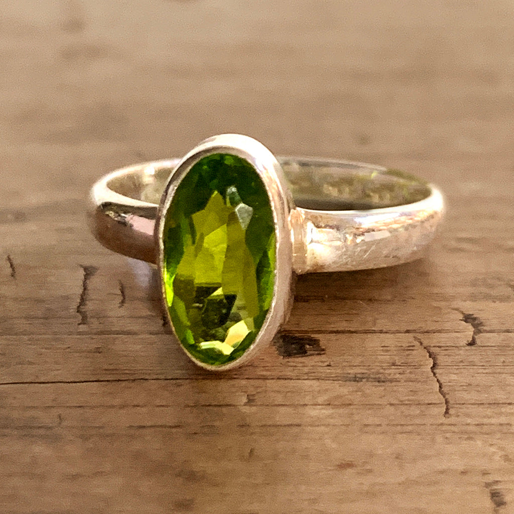 Oval Peridot Set in Silver Ring
