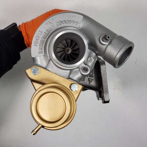 D99R724 Mitsubishi Dodge TE04H Turbocharger Rebuilt - Goldfarb & Associates Inc