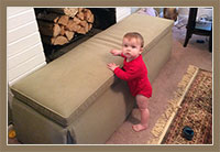 The HearthSoft® is a childproofing cushion that safely covers the fireplace hearth.