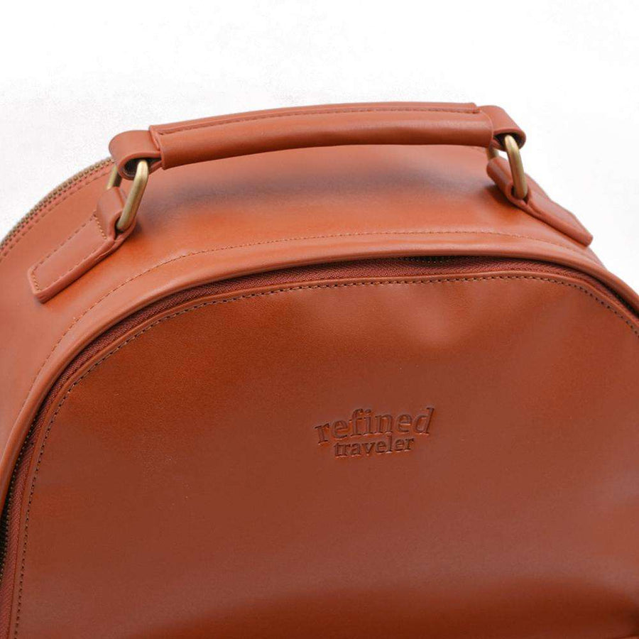 Handle on tan vegan leather backpack by Refined Traveler