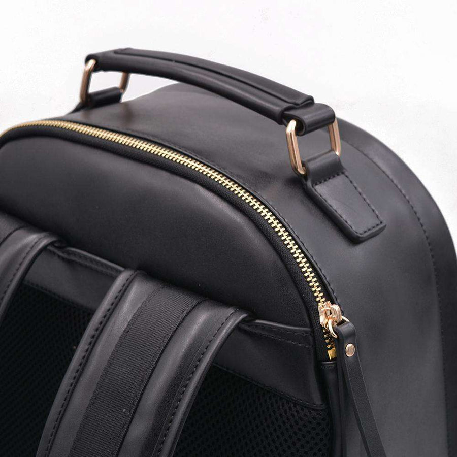 Laptop sleeve view of black vegan leather backpack by Refined Traveler