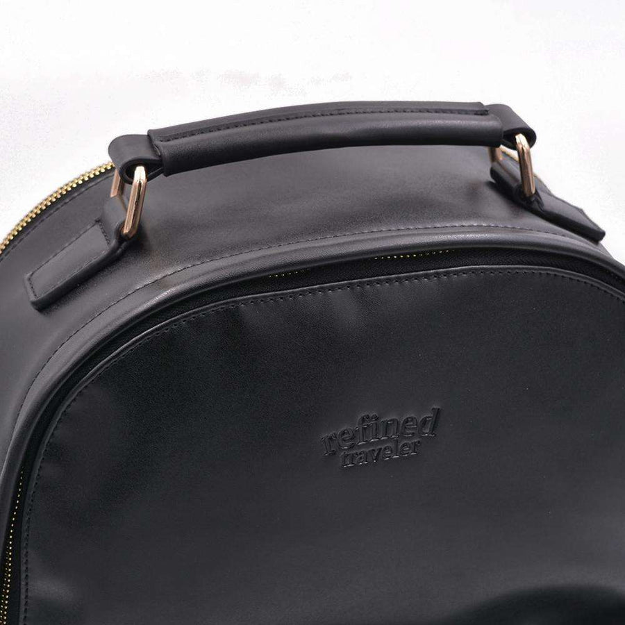View of handle of black vegan leather backpack by Refined Traveler