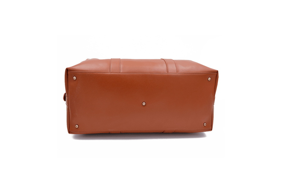 Bottom view of tan vegan leather duffel bag by Refined Traveler