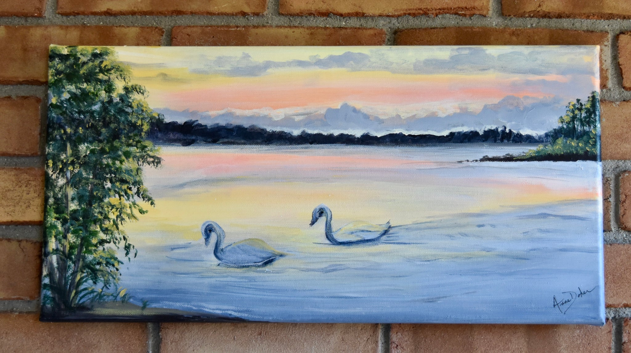 Swans on a Quiet Sunlit Lake