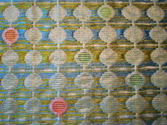 Graphic handwoven fabric with green, blue and red circles
