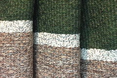 Handwoven wool and cotton textured fabric in brown, cream and forest green