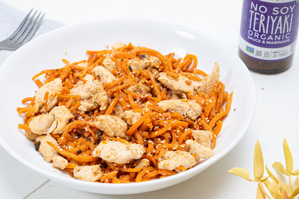 carrot noodles with chicken and Primal Kitchen No Soy Teriyaki Sauce on a white plate