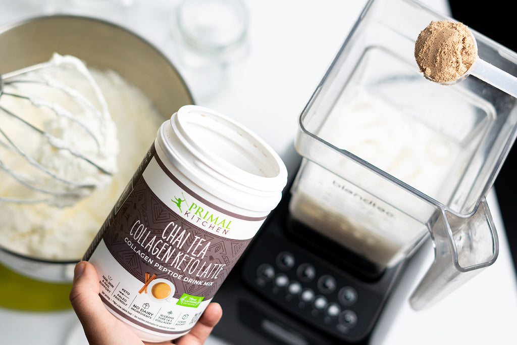 Scooping Primal Kitchen Chai Tea Collagen Keto Latte Drink Mix into a blender