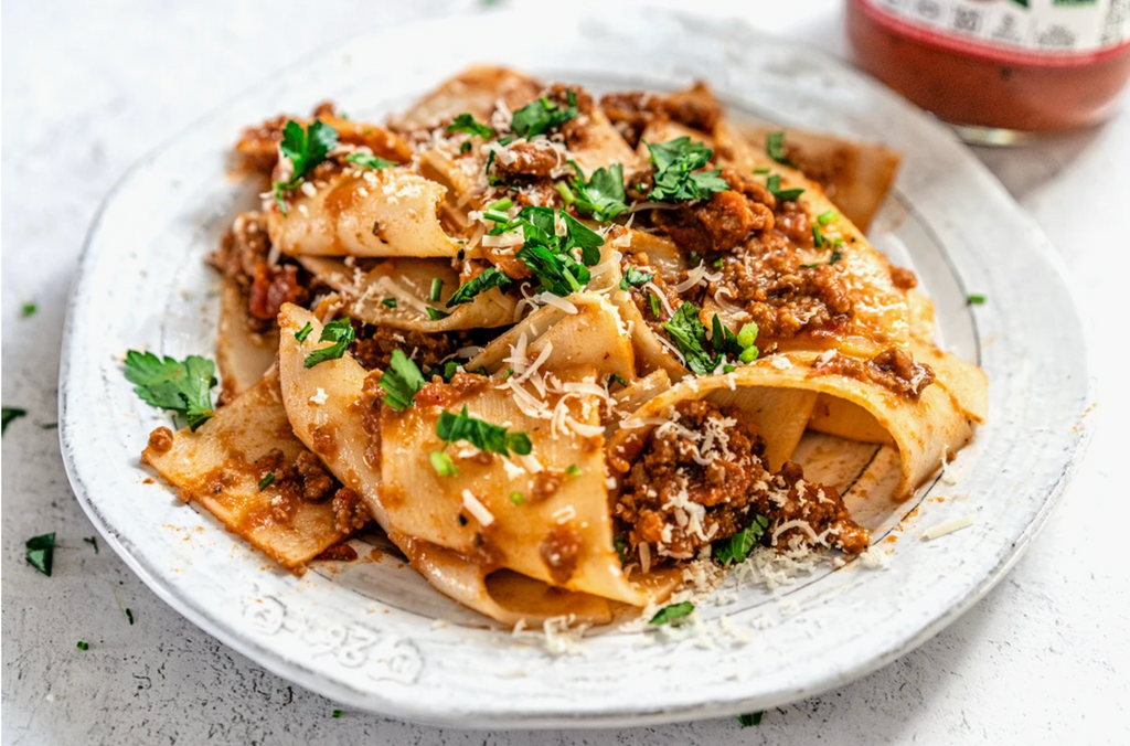 5-Ingredient Papparadelle is on a white plate, covered with Arrabbiata sauce.