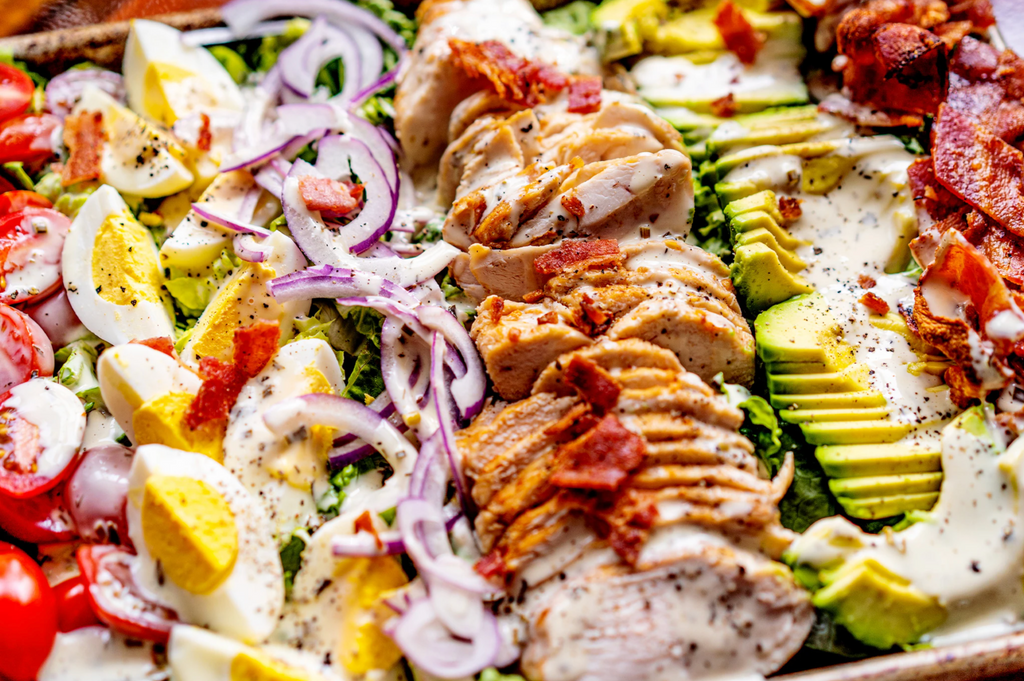 Keto Cobb Salad drizzled in ranch dressing.