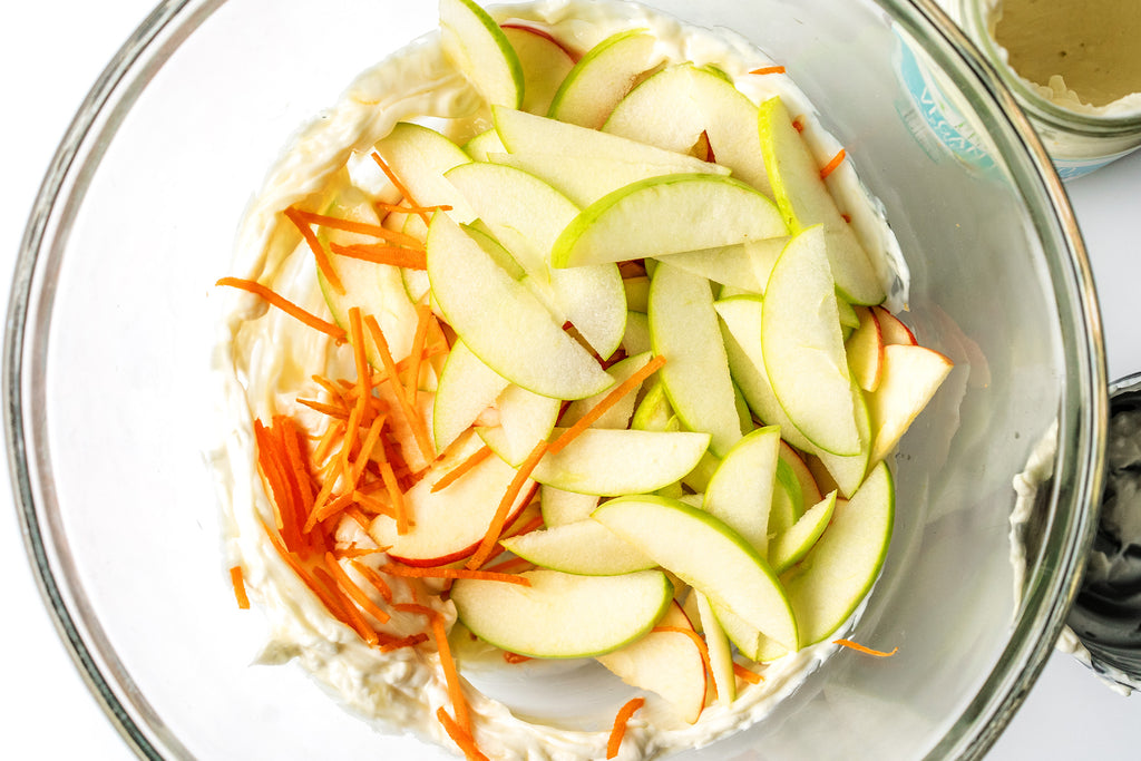 Vegan Coleslaw with Apples in a big mixing bowl