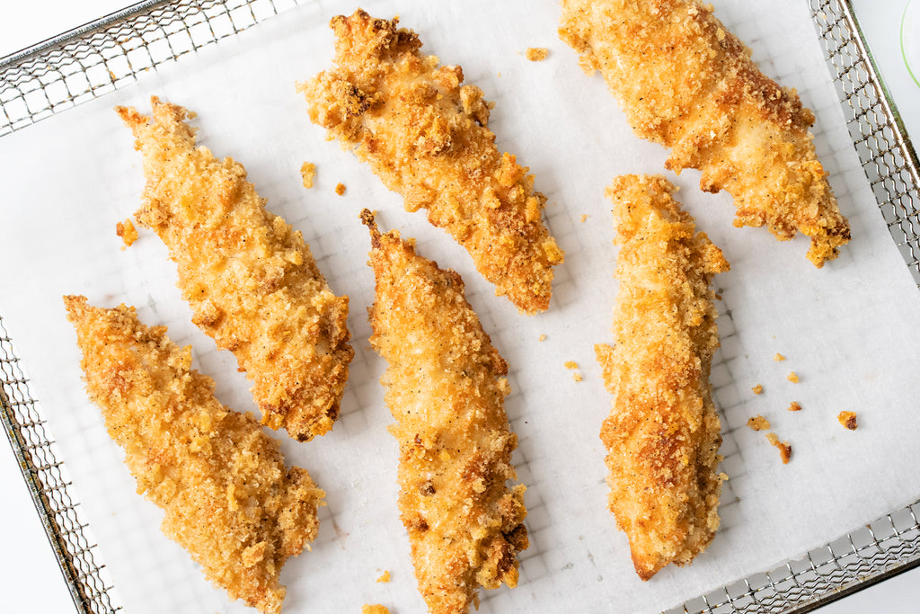 Paleo chicken tenders on parchment paper