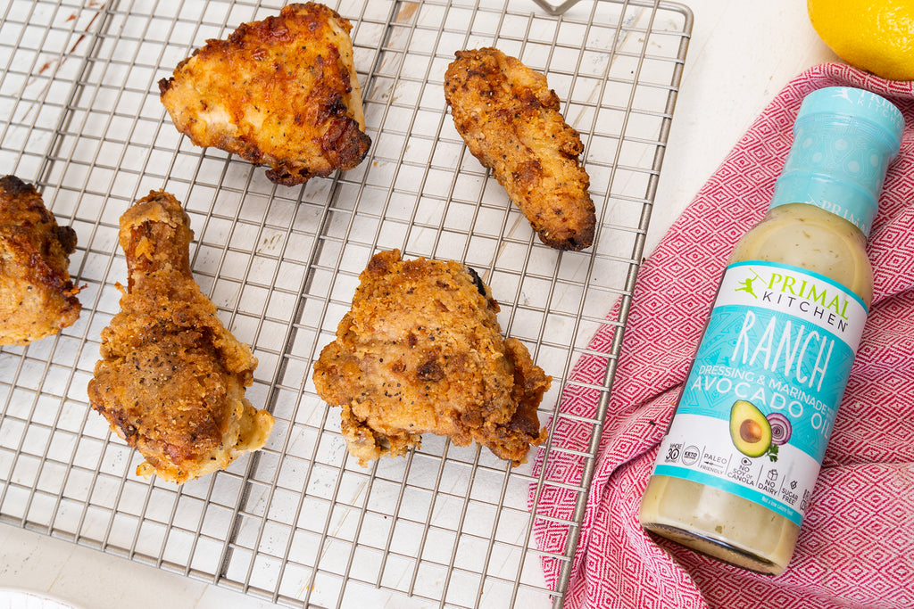 Ranch fried chicken resting on a cooling rack