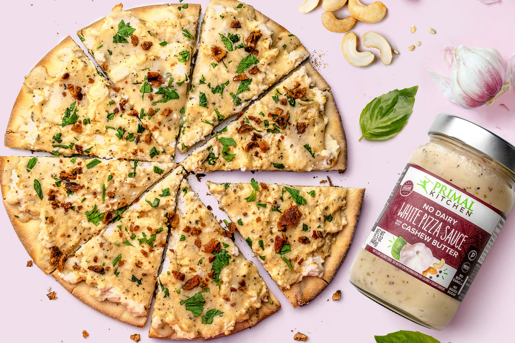 Ricotta, bacon, and basil top this pizza made with vegan white pizza sauce.
