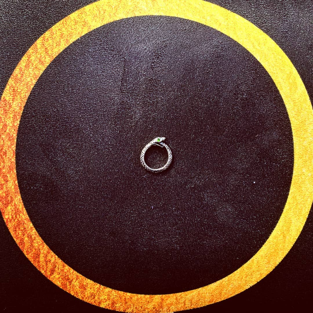 Ouroboros pendant on a 'Waxing Crescent Phases of the Moon' Big Raven Yoga mat
