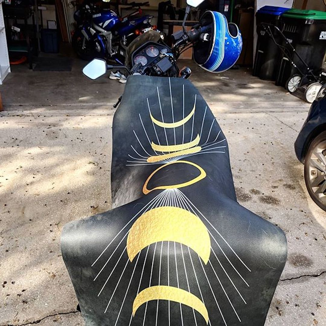 'Waxing Crescent Phases of the Moon' Big Raven Yoga mat laid out on a motorcycle to dry