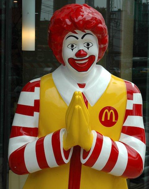 Ronald McDonald Greeting Customers in Thailand with a Wai Gesture