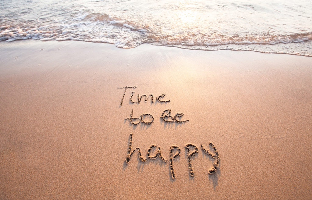 Time to Be Happy written in the sand on the beach