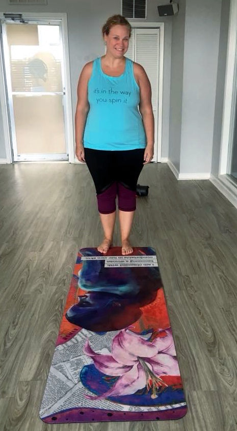 Kathy standing with her mat