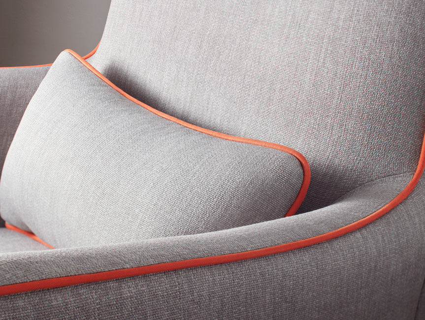 Modern Grazia Glider Detail - pebble grey body with orange piping shown.