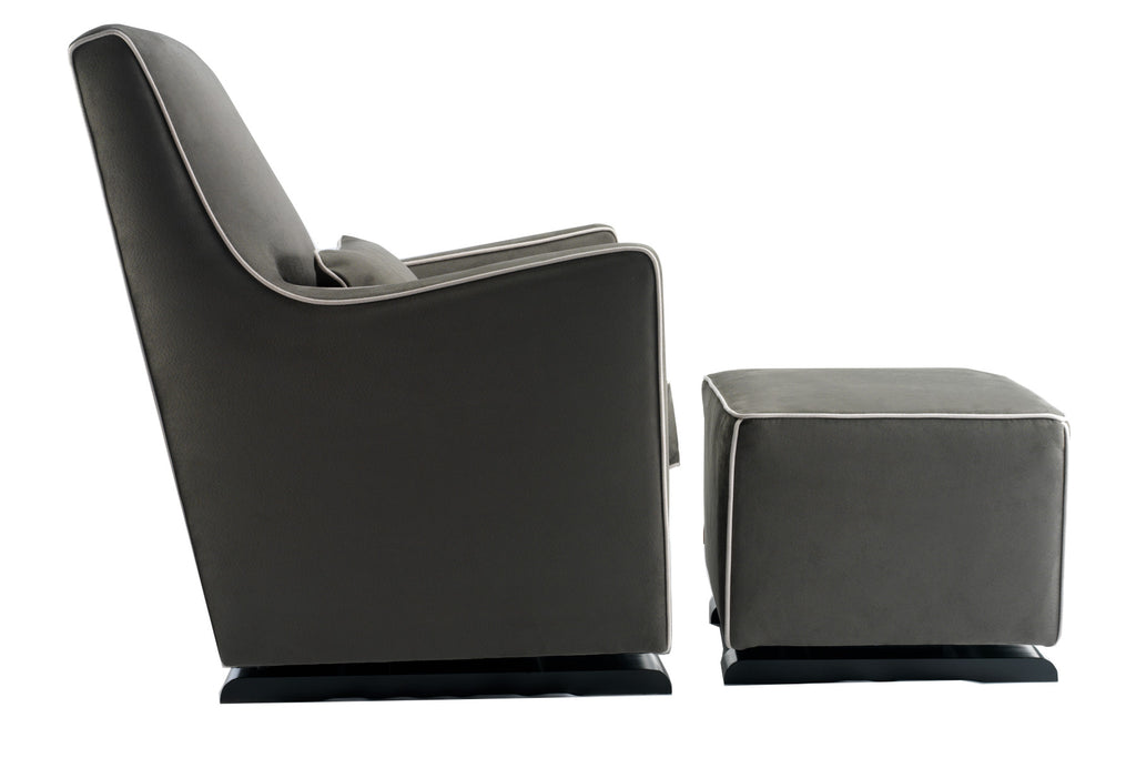 modern upholstered luca glider and ottoman - charcoal with stone piping shown.