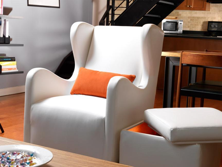 Modern Vola Glider and Storage Ottoman - white with orange pillow shown.