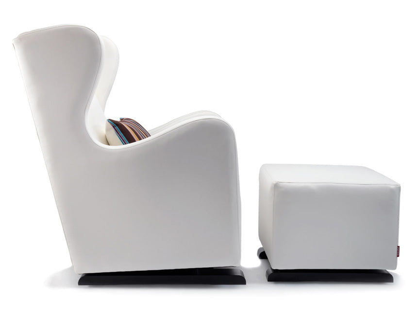 Modern Vola Nursery Glider and Ottoman - white with Paul Smith pillow shown.