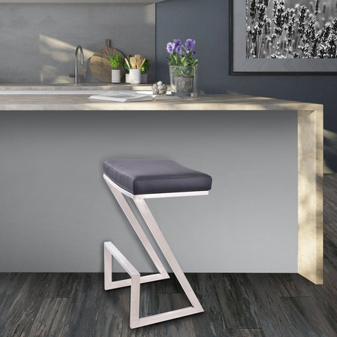 "Armen Living LCAT26BABLK Atlantis 26"" Counter Height Backless Barstool in Brushed Stainless Steel finish with Black Faux Leather"