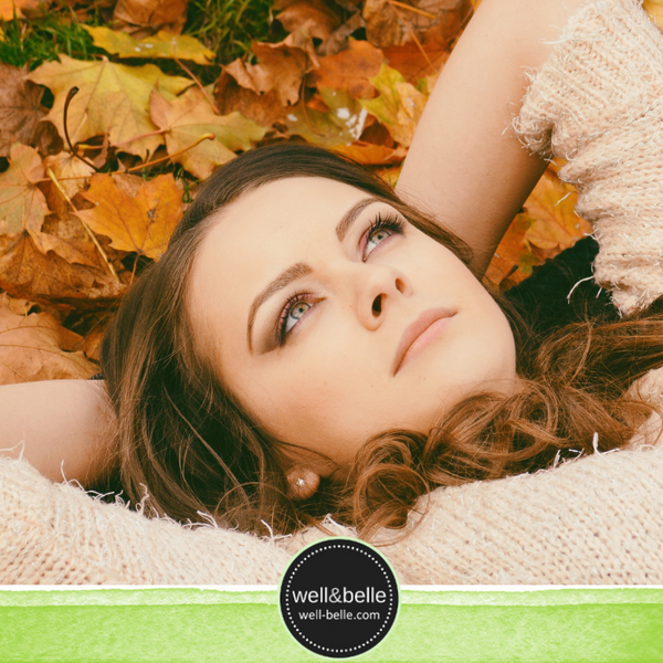 beautiful woman with beautiful skin with fall leaves