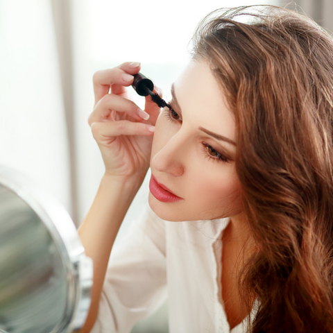 Image of woman applying mascara on well-belle.com, well&belle natural beauty